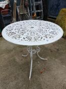 A VINTAGE CAST IRON GARDEN TABLE.