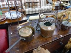 THREE ANTIQUE COPPER KETTLES, A SAUCEPAN, A WINE RACK AND AN IRON SCROLL STAND.