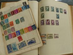 TWO WORLD STAMP ALBUMS.