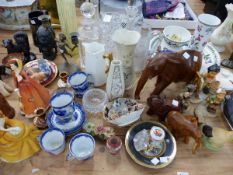A QUANTITY OF VARIOUS DECORATIVE CHINA WARES, HUMMEL FIGURINES, THREE DECANTERS, VASES ETC.