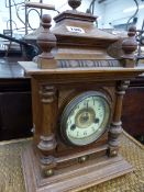 A VICTORIAN WALNUT CASED MANTLE CLOCK AND A BAMBOO SMALL TABLE.