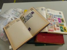 VARIOUS STAMP ALBUMS AND A LARGE QUANTITY OF LOOSE STAMPS.