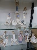 NINE NAO FIGURINES, TOGETHER WITH FOUR FURTHER DECORATIVE SIMILAR FIGURINES (13).