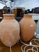 TWO SIMILAR TERRACOTTA LAMP BASES.