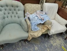 A LATE VICTORIAN BUTTON BACK ARMCHAIR AND TWO LATER ARMCHAIRS.