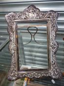 AN ANTIQUE SILVER MOUNTED AND TORTOISESHELL PHOTO FRAME, A PLATED TRAY, AND A SWAN VESTA.