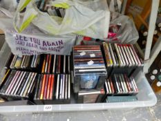 A QUANTITY OF CDS AND DVDS.