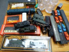 A SMALL COLLECTION OO GAUGE LOCOMOTIVES AND STOCK.
