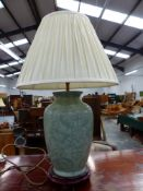 A MODERN CHINESE STYLE GREEN GLAZED LAMP