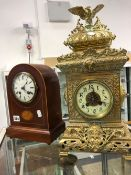 AN INLAID WOODEN MANTLE CLOCK,TOGETHER WITH A FURTHER FRENCH BRASS ORANTE MANTLE CLOCK.
