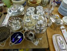 A QUANTITY OF SILVER PLATED WARES, INC. COCKTAIL SHAKER, WINE CARRIER, CANDLE STICKS ETC.