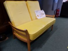 AN ERCOL SMALL COTTAGE SETTEE.