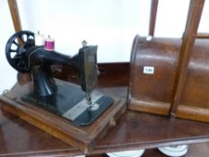 A VINTAGE SEWING MACHINE.