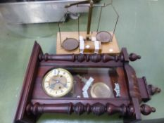 A VICTORIAN WALL CLOCK AND A SCIENTIFIC BALANCE.