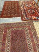 THREE VINTAGE HAND WOVEN EASTERN RUGS.