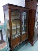 AN EDWARDIAN INLAID DISPLAY CABINET.