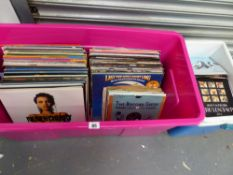 A LARGE QUANTITY OF RECORD ALBUMS AND SINGLES.