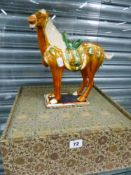 A GLAZED TANG STYLE HORSE.