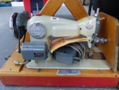 A VINTAGE JONES SEWING MACHINE.