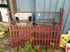 A PAIR OF GOOD QUALITY PAINTED IRON DRIVEWAY GATES AND ONE OTHER IRON GATE.