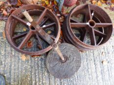 SIX MATCHING CAST IRON CART WHEELS ETC.