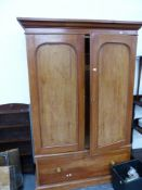 A VICTORIAN STAINED PINE WARDROBE AND A SMALL OAK BOOKCASE.