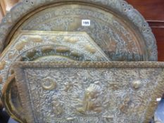 FOUR VARIOUS EASTERN BRASS TRAYS.