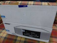 A BOSE WAVE CD STEREO, AS NEW BOXED.
