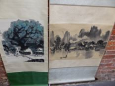 TWO CHINESE SCROLLS, ONE DEPICTING A MAN PUNTING TOWARDS A MOUNTAINOUS COAST. 50.5 x 75cms. THE