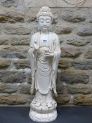 A BLANC DE CHINE FIGURE OF THE BUDDHA STANDING ON A DOUBLE LOTUS PLINTH, HIS RIGHT HAND RAISED IN