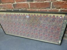 A FRAMED INDIAN TEXTILE PANEL WOVEN WITH STYLISED RED AND BLUE FLOWERS AND BOTEH, THE EBONISED