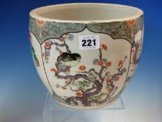 A CHINESE FAMILLE VERTE PLANTER PAINTED WITH FOUR PANELS OF FLOWERS AND BIRDS ON A BLACK STIPPLED