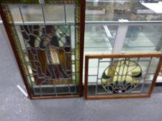 TWO MAHOGANY FRAMED LEADED GLASS PANELS, ONE OF A FIGURE WITH THE TITLE FRANCE. 99 x 66cms. THE