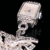 A CONTINENTAL SILVER AND MARCASITE MANUAL WOUND BUCHERER BROOCH FOB WATCH.