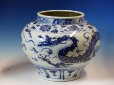A CHINESE BLUE AND WHITE COMPRESSED SPHERICAL JAR PAINTED WITH A DRAGON CHASING A FLAMING PEARL
