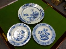 A PAIR OF 18th C. CHINESE BLUE AND WHITE PLATES CENTRALLY PAINTED WITH FLOWERS AMONGST ROCKS. Dia.