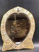 AN ANTIQUE VICTORIAN HEART SHAPED SILVER FRAMED AND WOODEN EASEL BACKED DRESSING TABLE MIRROR. THE