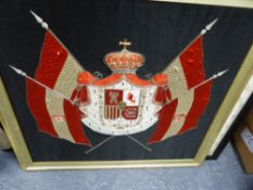 A MACHINE WOVEN SILK ARMORIAL ON A BLACK GROUND, POSSIBLY THAT OF AN AUSTRIAN ARCHDUKE AND SUPPORTED
