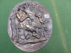 AFTER CLODION, A 19th C. BRONZE OVAL PLAQUE DEPICTING IN RELIEF A SATYR SEATED ON A BENCH WHILE