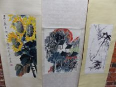 THREE CHINESE SCROLLS DEPICTING HOUSES AMONGST SPRING BLOSSOMS AND FOLIAGE. 58.5 x 43cms.