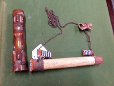 AN AFRICAN BONE MALE FERTLITY FIGURE. H 16cms. TOGETHER WITH PENDANT NECKLACE, THE ROUND ENDS OF THE