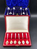 A CASED SET OF SIX HALLMARKED SILVER AND GUILLOCHE ENAMEL TEA SPOONS, DECORATED WITH A FLORAL