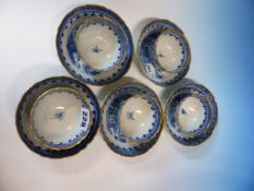FIVE CHINESE BLUE AND WHITE TEA BOWLS, FOUR SAUCERS AND A LARGER BOWL