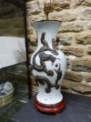 A CHINESE CRACKLEWARE BALUSTER VASE AS A LAMP WITH TWO BRONZED DRAGONS ON ONE SIDE OF THE CHERRY