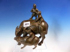 A CHINESE BRONZE GROUP OF THREE CHILDREN RIDING A WATER BUFFALO AND ITS CALF. H 19cms.