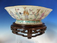 A 19th C. CANTON QUATREFOIL BOWL AND WOOD STAND, THE EXTERIOR PAINTED WITH DAOIST IMMORTALS. W 26.