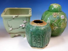 A CHINESE GREEN GROUND JAR AND COVER MOULDED IN RELIEF AND PAINTED WITH A CRANE AMONGST LOTUS. H