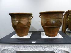 A PAIR OF TERRACOTTA TWIN HANDLE BALUSTER FORM GARDEN PLANTERS WITH INCISED DECORATION. H. 56 x
