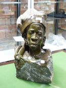 NICHOLAS TANDI (BORN 1949), A GREEN STONE BUST OF A SHONA MAN, THE TOP OF HIS HAT AND HIS CHEST IN