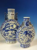 TWO 19th C. CHINESE BLUE AND WHITE MOON FLASKS, THE TALLER PAINTED WITH ROUNDELS OF DRAGONS. H